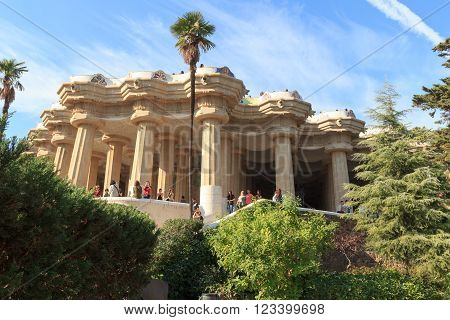 Barcelona, Spain - November 10, 2015: Park Guell Sala Hipostila columns and main terrace. It is a public park system composed of gardens and architectonic elements. The park was built between 1900 and 1914 and was designed by Antoni Gaudi.