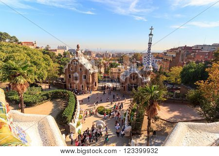 Barcelona, Spain - November 10, 2015: Park Guell entrance buildings. The Park Guell is a public park system composed of gardens and architectonic elements. The park was built between 1900 and 1914 and was designed by Antoni Gaudi.