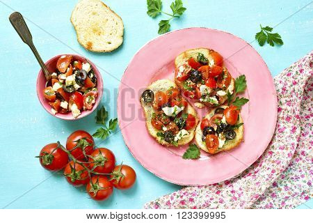 Crostini With Tomatoes,feta And Olives.