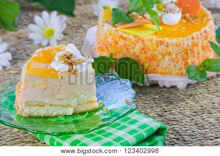 a delicious sweet cake is beautifully decorated with the cut piece on a saucer