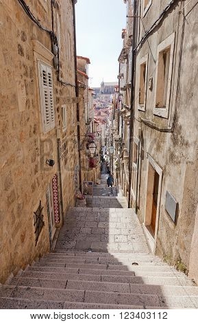 DUBROVNIK CROATIA - FEBRUARY 19 2016: Narrow medieval street in Old Town of Dubrovnik (UNESCO site) Croatia. Dubrovnik was a popular filming site for HBO drama Game of Thrones