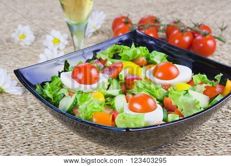 lettuce from vegetables with fresh greenery in a decorative dish