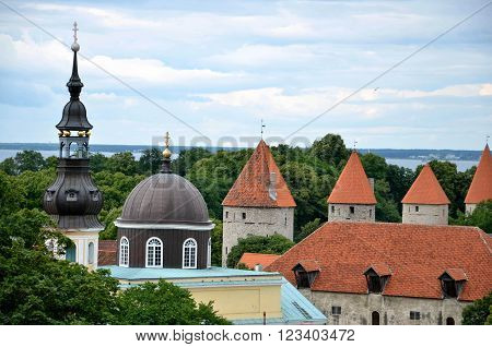 TALLINN / ESTONIA - July 27 2013: Church of the Transfiguration of Our Lord in Tallinn next to medieval town wall
