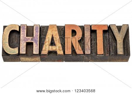 charity - isolated word in vintage letterpress wood type stained by color inks