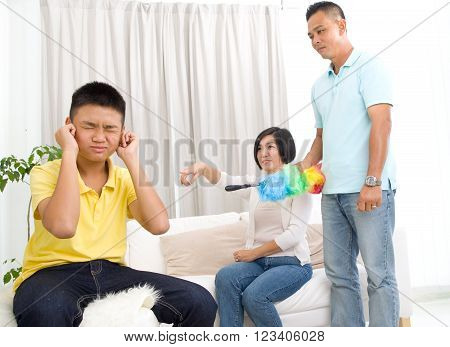 people misbehavior family and relations concept - upset or feeling guilty boy and parents at home
