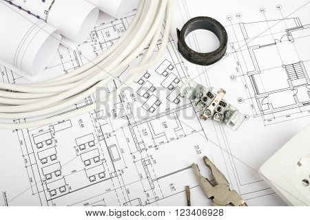 Architecture plan and rolls of blueprints with cabel and plug. Building concept