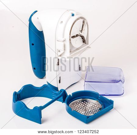 wool shaver with accessories on white background.
