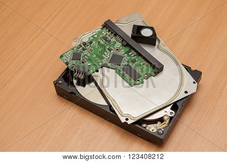 Disassembled Hard Drive. Details Of A Pile On A Wooden Table.