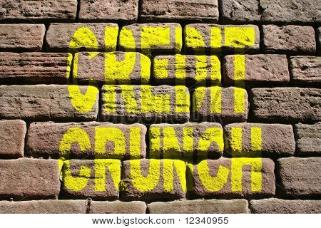 credit crunch painted on brick wall