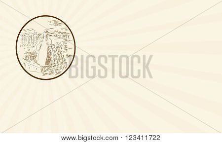 Business card showing Etching engraving handmade style illustration of an olive oil jar with cheese and grape bunch set against a Tuscan countryside inside circle shape.