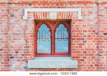 Old red brick wall with traditional Window.