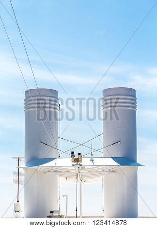 White Ships Smokestacks on a blue sky
