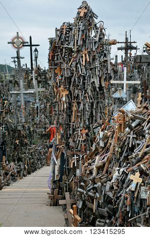 Cca 12 km north of the city of SIAULIAI / LITHUANIA - July 24 2013: Close view of the Hill of Crosses a place of worship for Christians