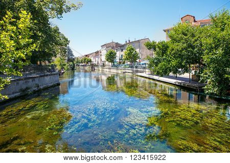 L'Isle-Sur-La-Sorgue, a small typical town in Provence, France. Beautiful village, with view on roof and landscape, small cafe and restaurants.