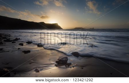 Sunset at Rhossili Bay and Worms Head on the Gower peninsula, South Wales ** Note: Shallow depth of field