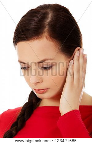 Young woman with ear ache