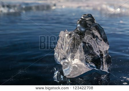 Clump of clear ice. Beautiful winter landscape in the Lake Baikal.