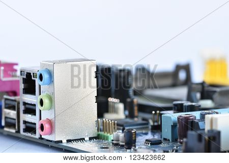Rear view of the connectors on the motherboard of a personal computer. Isolated on a clean white background. Concept - electronics, internet and modern technology.