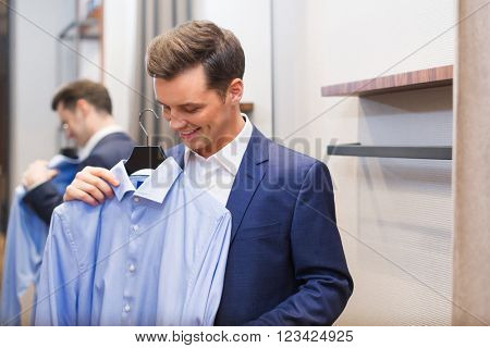 Young man with shirt in locker-room