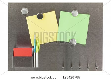 Magnet bulletin board with blank papers, ballpoint-pen and pencil isolated on white background