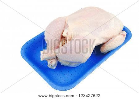 whole raw chicken on blue tray isolated on white background
