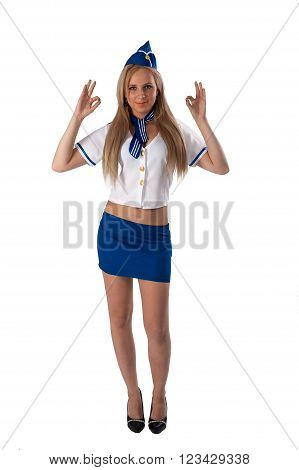 Attractive young stewardess showing thumb up gesture