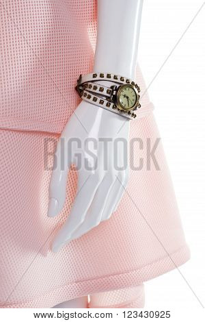 Classic watch on female mannequin. Female mannequin's arm with watch. Vintage watch with leather strap. Round watch with white strap.