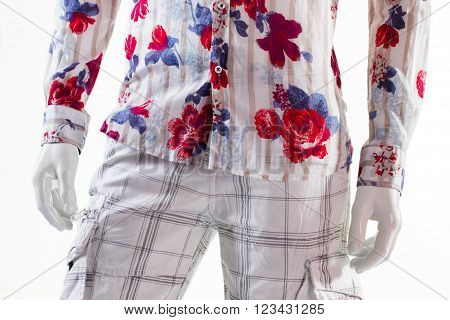 Shirt and shorts on mannequin. Male mannequin in summer apparel. Cargo shorts and floral shirt. Checkered shorts with cotton shirt.