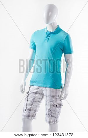 T-shirt and shorts on mannequin. Male mannequin wearing summer clothes. Blue t-shirt and white shorts. Cargo shorts with polo t-shirt.
