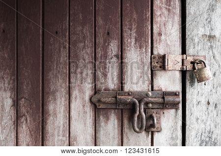 locked old wooden door with rusty padlock copy space.