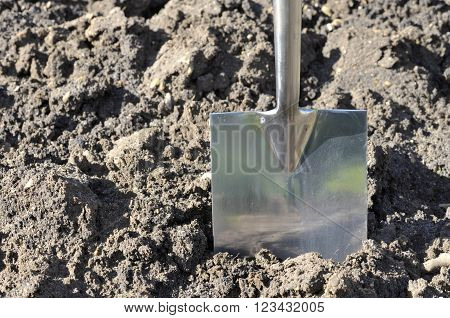 Soil preparation by digging with a garden spade.