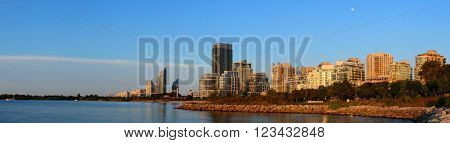 Toronto cityscape panorama at waterfront in the morning after sunrise.