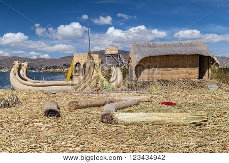 Hut And Canoe Boat At Uros Floating Island And Village On Lake Titicaca Near Puno,  Peru
