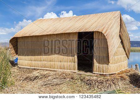 Hut At Uros Floating Island And Village On Lake Titicaca Near Puno,  Peru