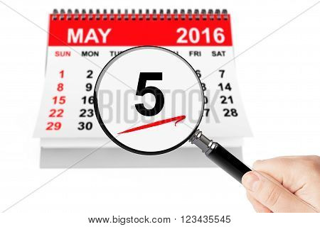 Ascension Day Concept. 5 may 2016 calendar with magnifier on a white background