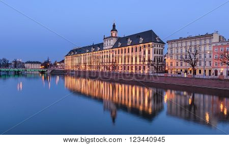 Wroclaw university, view from river Odra, in the evening. Poland. Europe.