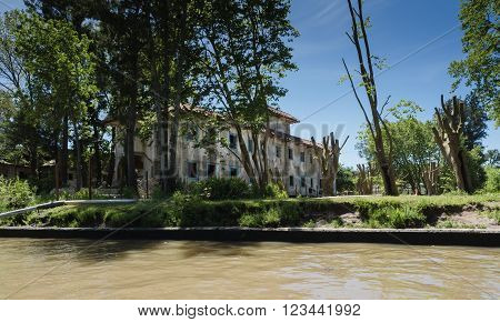 Buenos Aires Argentina - 29th October 2015: Interesting architectural abandoned buildings seen during a boat trip in the River Plate delta.