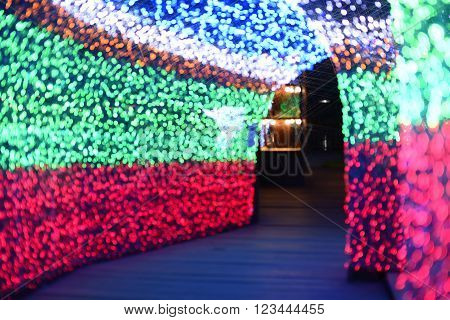 De focused Christmas Light-colored walkway tunnel .
