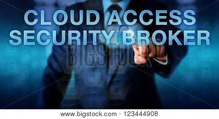 Enterprise IT manager is pushing CLOUD ACCESS SECURITY BROKER on a virtual touch screen interface. Business metaphor and information technology concept for trading secure cloud computing access.