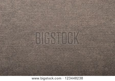 Embossed peper background brown color close up