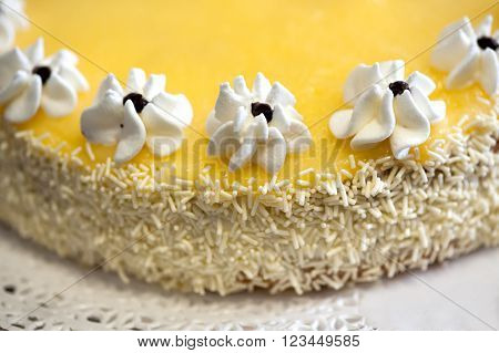 Lemon Cake With Icing Flowers And Coconut