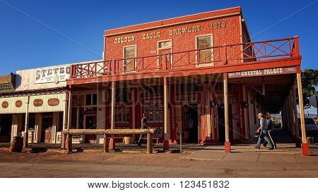 TOMBSTONE, ARIZONA - MARCH 20: Tourists walk past the historic Crystal Palace in Tombstone, Arizona on March 20th, 2016.