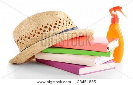 Travel set: books, hat and suntan oil, isolated on white