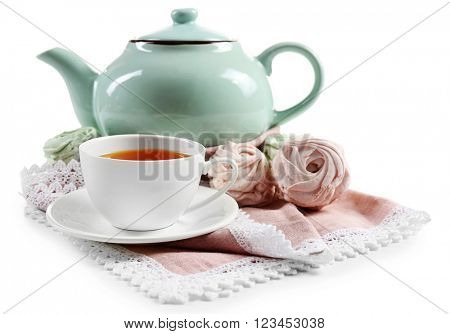 Black brewed tea with ceramic utensils and sweets, isolated on white