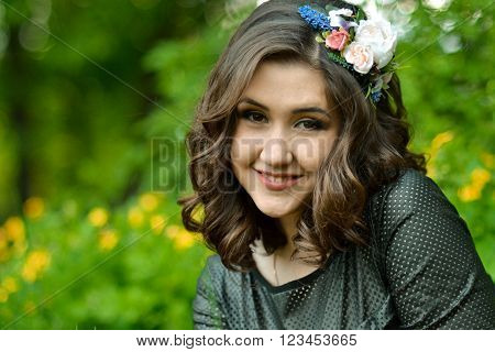 Close-up portrait of very beautiful, attractive, cute, excellent, smiling, lovely, adorable girl, woman with cute, nice, white, healthy smile in spring green park. White, healthy smile. Cute smile. Beautiful smile.