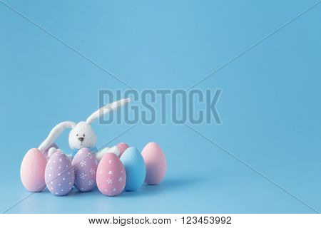 Rabbit With Easter Eggs On Blue