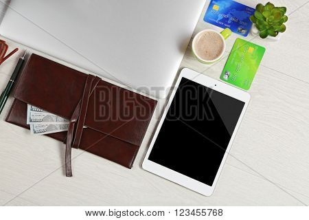 Office supplies and money on a white desk, top view