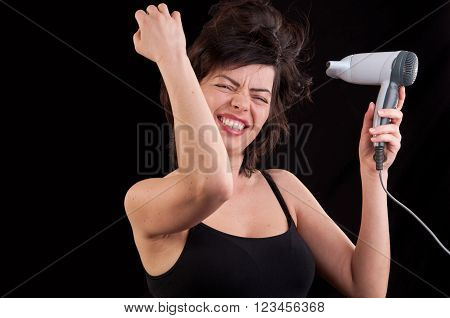 Attractive Cheerful Woman Blows Dry Her Hair With Hairdryer, Over Black