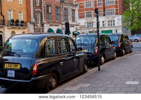 LONDON UK - April 14 2015: three London vintage cabs waiting in the street UK