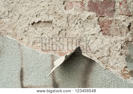 Detail of aged brick wall background. Broken exterior of a building